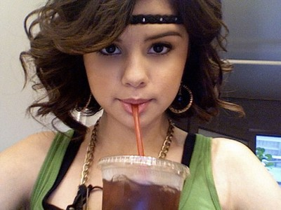 Selena Gomez cute pose while drinking tea
