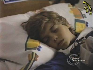 """Matthew Lawrence is very young here. Matt sleeping in a TV movie """"David"""" in 1988. So cute!"""