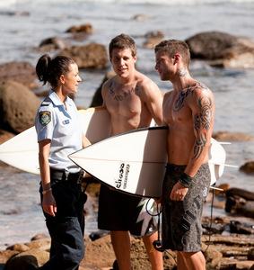 Daniel Ewing holding a surfboard :)