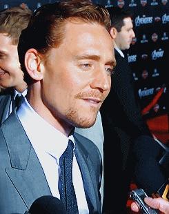 Tom Hiddleston biting his lip? Oh, you!