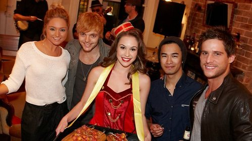 Daniel Ewing with H&A cast in a restaurant.