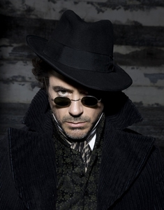 Robert Downey Jr IS actually Sherlock Holmes to me but I think we can count it as a character anyway! XD