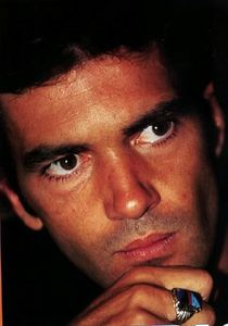 Banderas serious and thoughtful.