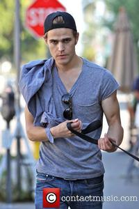 Paul Wesley wit a stop sign behind him