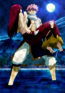 Natsu and Erza.Both of them are strong and fierce and it's obvious they care for each other alot.