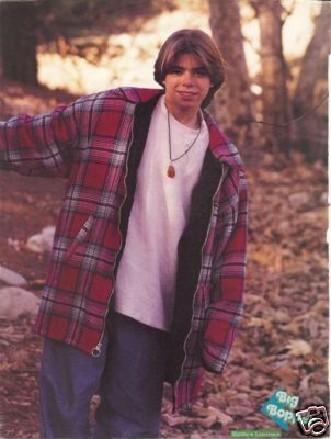 Matthew around 13 years old, chilling in the woods. <33