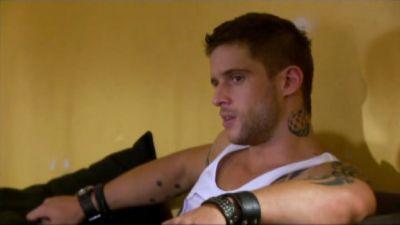Daniel Ewing as Heath sitting on a couch.