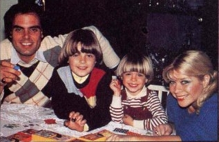 Matthew in the red overalls with his older brother, Joey and his parents, Joseph and Donna. <33