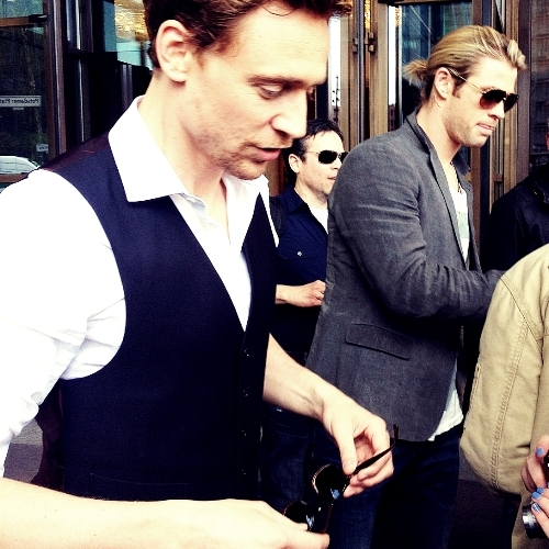 Toms' glasses in his hands and Chris is wearing his..<3