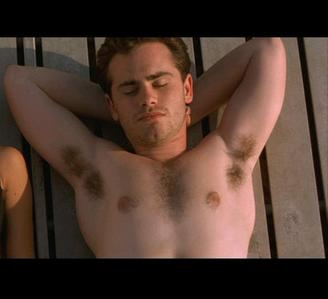 Rider Strong from BMW in cabina Fever with his head resting on his hands.