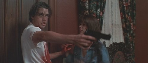 Skeet Ulrich in Scream with a messy bloody kemeja on.