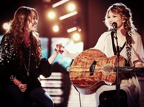 Here is mine, Taylor sitting with Miley, holding the guitar close to her heart! <3