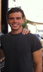 Matthew wearing a gray shirt. <333