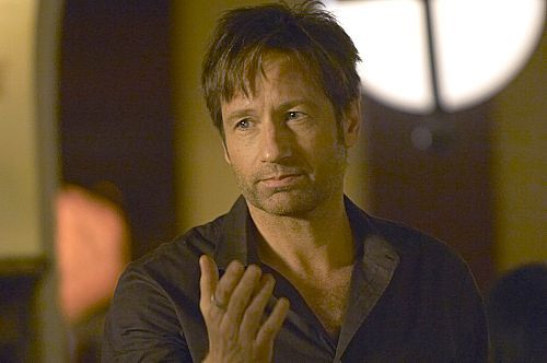 David Duchovny as Hank Moody anda can barely see the ring but it's there...