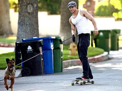 Here is mine.Kellan Lutz on a skateboard with his dog,Kola pulling him.