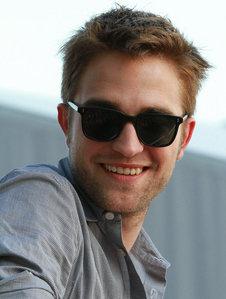Robert Pattinson wearing a gray shirt.