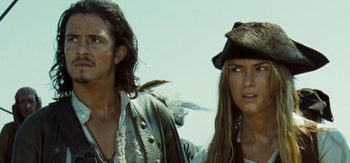 Will and Elizabeth from Pirates of the Caribbean: Dead Man's Chest watching Jack parade around his jar of dirt.
