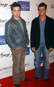 Matthew and his brother, Andy on a red carpet.