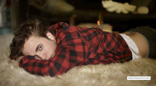 Robert Pattinson lying on a rug.This is one of my fave pics of him.