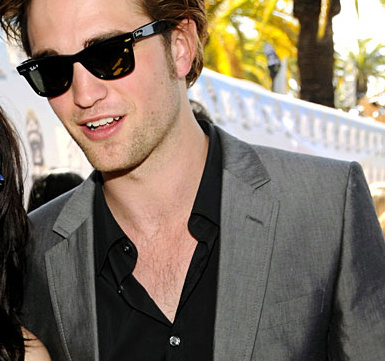 here is my pic,Robert Pattinson in a suit but no tie.