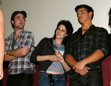 This is the only one I could find of Robert Pattinson(on far L),with his arms crossed.He is with his 2 Twilight co-stars,Kristen and Taylor.