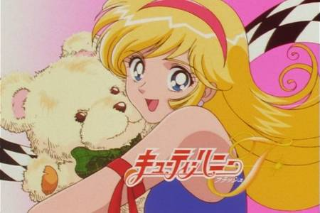 Cutey Honey. She transforms into a short haired red head though.
