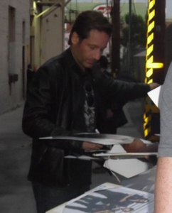 Dave signing an autographs for fans...