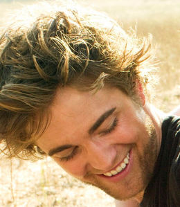 Here is Robert Pattinson,from a 2008 Vanity Fair Twilight cast bức ảnh shoot looking very happy.I tình yêu his smile.His smile is one of the many things I love.