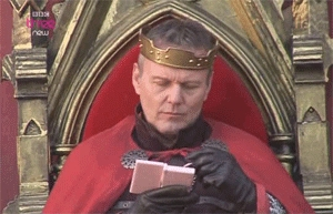 All I have is fandom specific pictures. so Take King Uther of Camelot playing with his merah jambu DS.