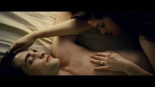 This is a pic of Robert Pattinson in a scene from BD part 2,with Kristen Stewart,laying down in katil and shirtless.This pic is so HOT!!!!!!!!!!!!Love this pic!!!!!!
