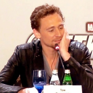 Tom Hiddleston He's sitting in a chair u just can't see it