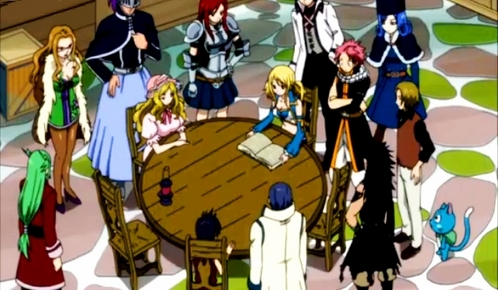 Lucy and the rest of the guild studying the book........from Fairy Tail ;P