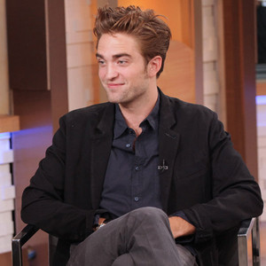 here is Robert Pattinson wearing a black suit koti, jacket on his appearance on GMA.