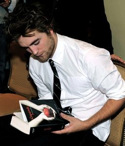 Here is mine of Robert Pattinson holding the Twilight book(in spanish).
