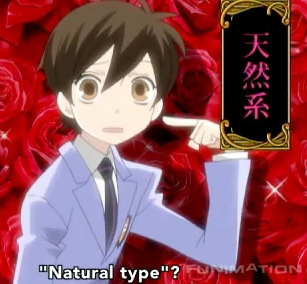 Well Haru-chan from Ouran has brown eyes!
