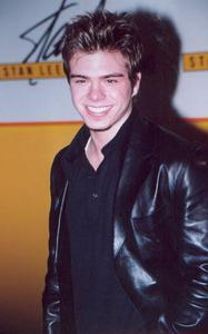 Matthew in a black leather coat. <33