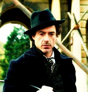 for me Sherlock Holmes is his sexiest character...not even Stark can beat him :3