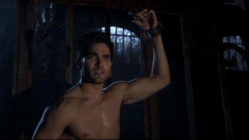 Tyler Hoechlin kind of looking down at tyler posey