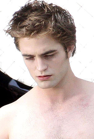 My sexy English guy Robert Pattinson(in a scene from New Moon)looking down.