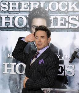 RDJ with Sherlock Holmes poster as background... for me the best beackground haha! XD