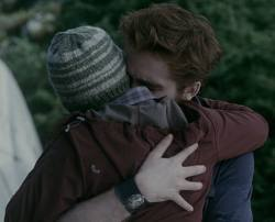 Robert hugging Kristen,as their characters Edward and Bella,in a scene from Eclipse.