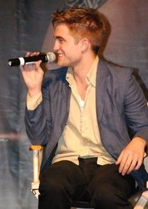 my sweet and sexy Rob sitting in a chair.