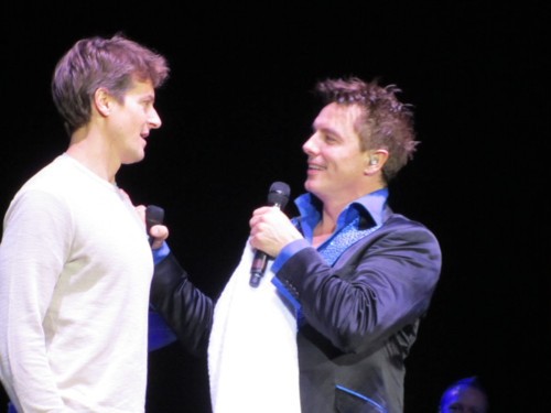 John Barrowman trying to get Scott's attention :) Such a perfect couple.