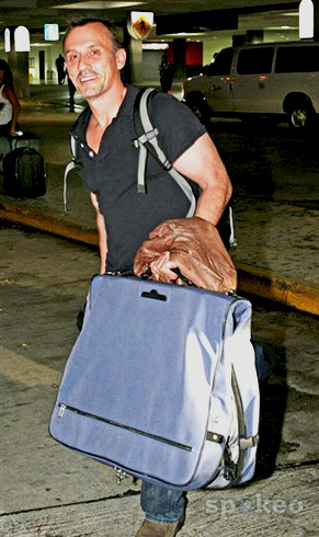 big bag. but his strong arm can wear that easily