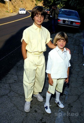 Joey and Matthew as young kids wearing white shoes. <33