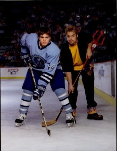 Matthew wearing a blue hockey suit. <33