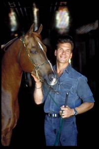 Patrick Swayze with one of his passions - farasi