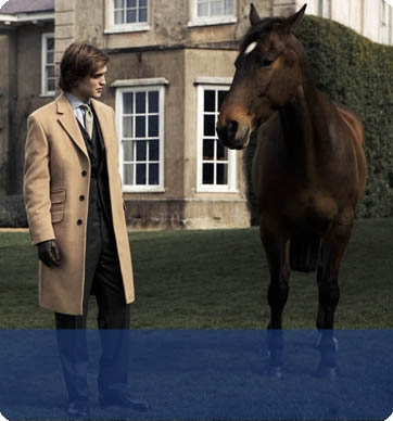 Here is my Robert with a horse.This is from a photoshoot.I have never seen this pic before,hope wewe like it.