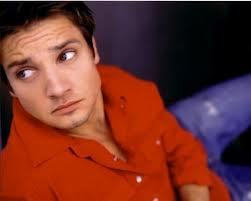 Jeremy wearing his red coat. :) -Jeremy Renner-