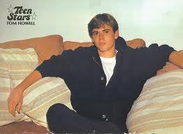 C. Thomas Howell arms wide and relaxed ;)
